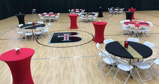 Red and black tables at school event
